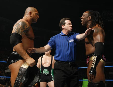 Batista Looks Angry With Booker T