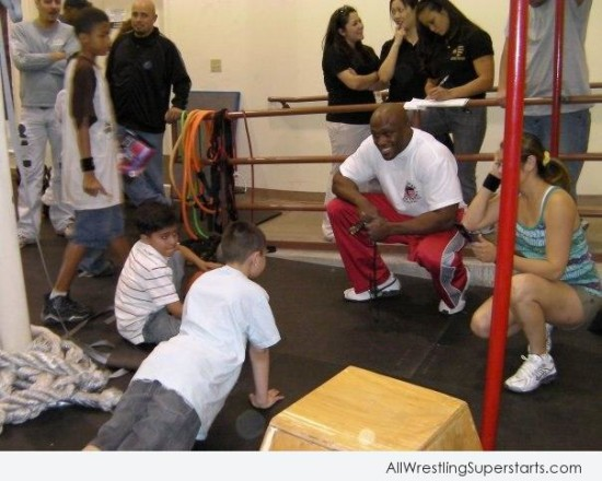 Bobby Lashley Giving Training To Child