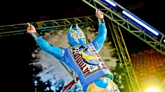 Sin Cara Raises His Hands For Audience