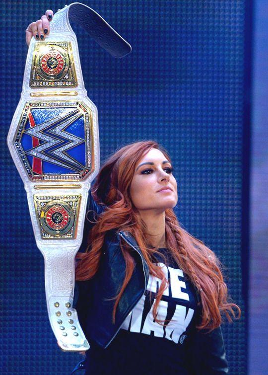 Becky Lynch Showing Her Title Belt