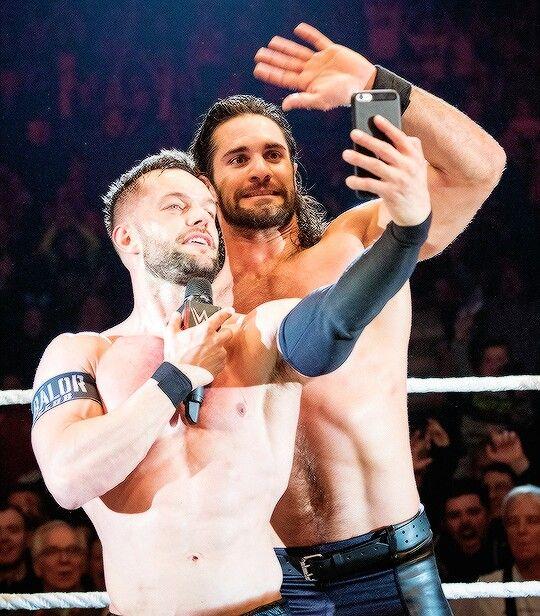 Finn Balor taking a Selfie with Seth Rollins